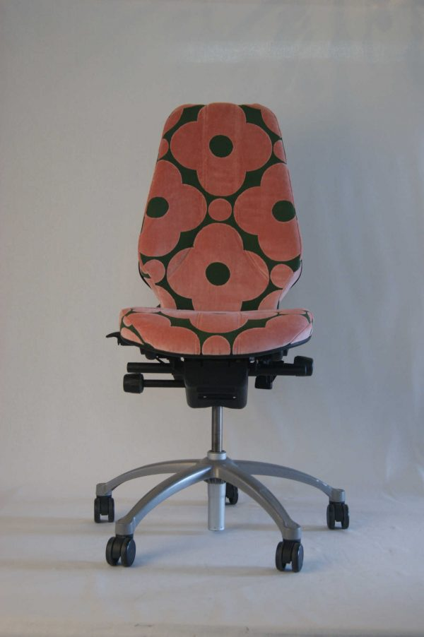 An upcycled RH400 desk chair reupholstered in Orla Kelly fabric.